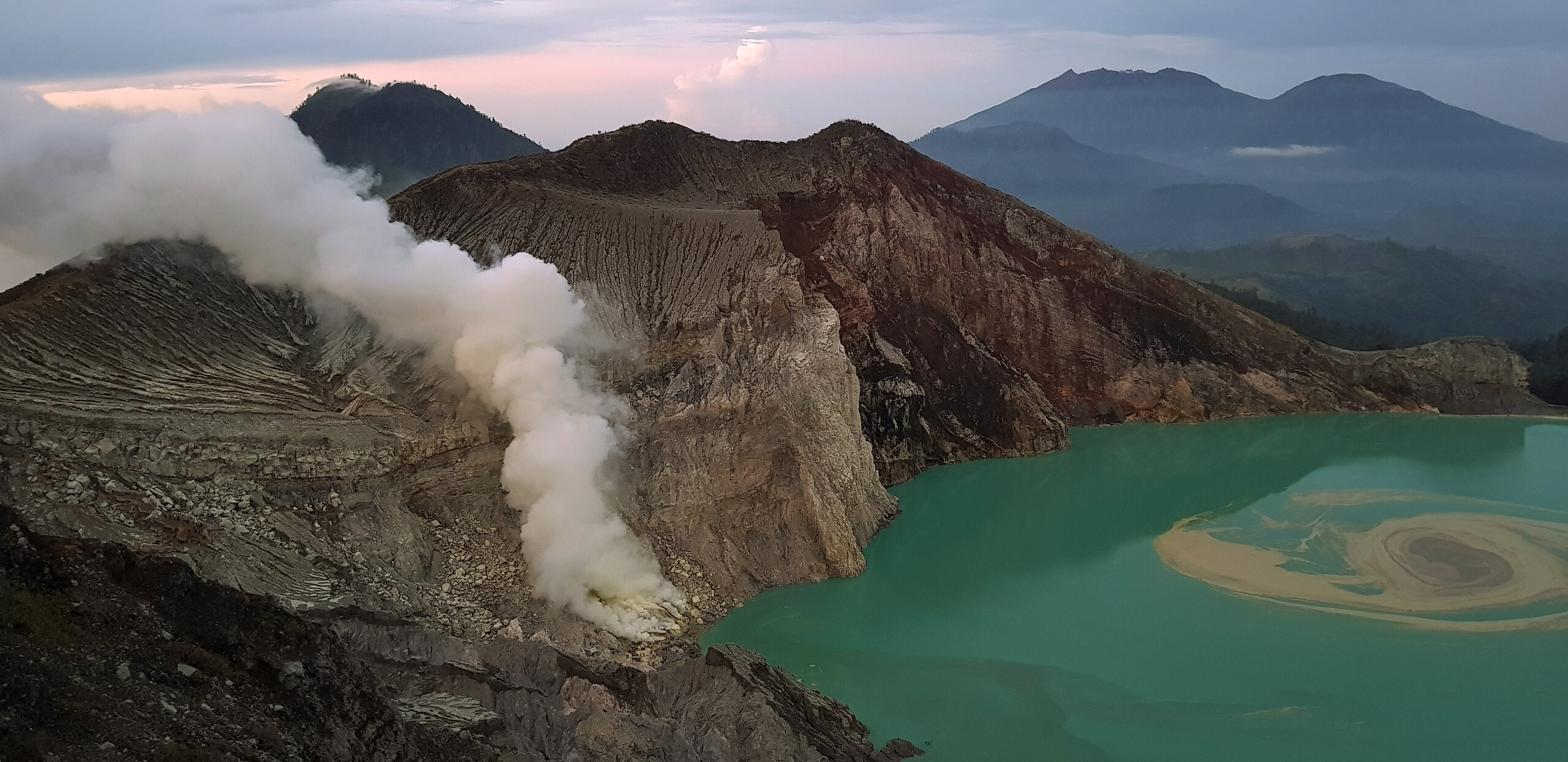 crater of ijen volcano, acid lake at the bottom, sulphur fumes