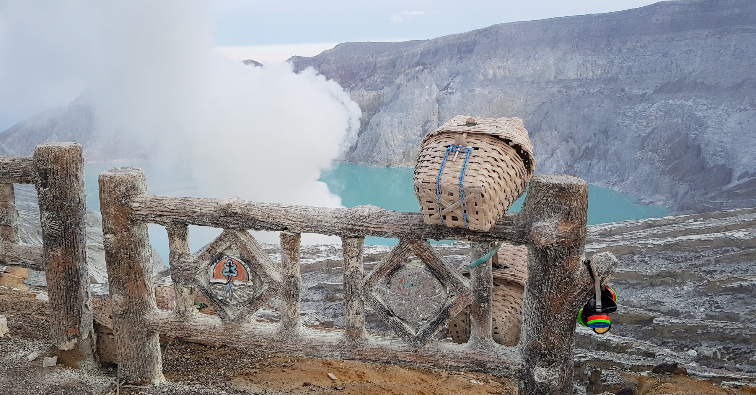 A Sulphur miner basket on the rim of Ijen volcano crater, overlooking the acid crater lake.